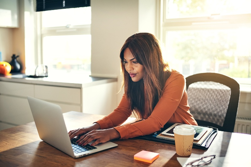 Canva - Young Female Entrepreneur Working Online in Her Home Office-1